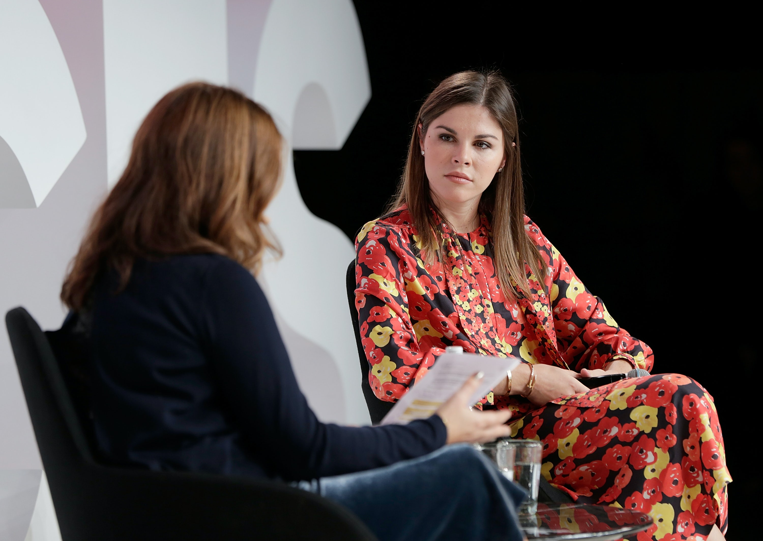 OXFORD, ENGLAND - DECEMBER 01:  Alexandra Shulman (L) and Emily Weiss speak on stage during #BoFVOICES on December 1, 2017 in Oxford, England.  (Photo by John Phillips/Getty Images for The Business of Fashion )