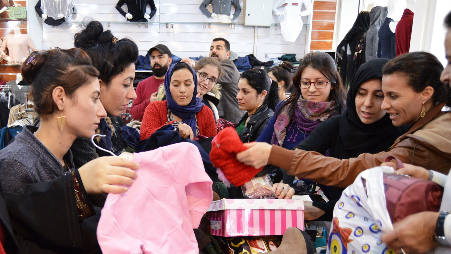 Yazidi women taken shopping by Khalsa Aid International | Photo: Savraj Kaur