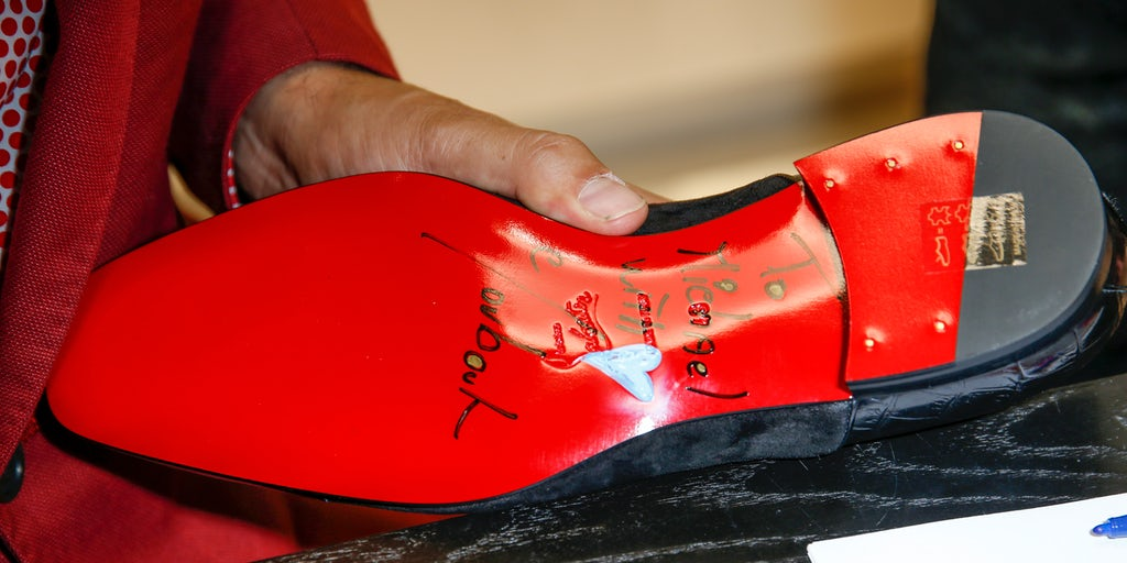 French Shoe Designer Red Soles