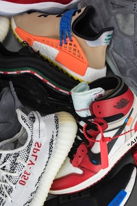 Pile of sneakers | Source: Goat x Flightclub