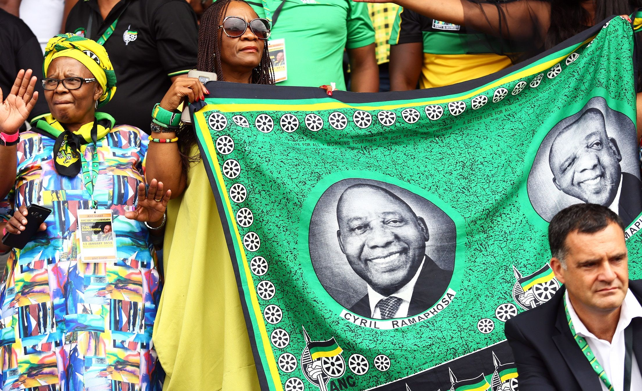 Supporters with material depicting newly elected African National Congress President, Cyril Ramaphosa during the ANC 106th anniversary celebrations at ABSA Stadium, East London, South Africa | Photo: STR/EPA EFE/REX/Shutterstock