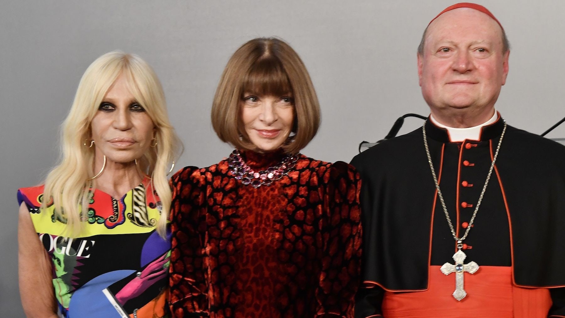 Donatella Versace with Anna Wintour and cardinal Gianfranco Ravasi, President of the Vatican Pontifical Council for Culture, at Rome's Palazzo Colonna | Source: Getty