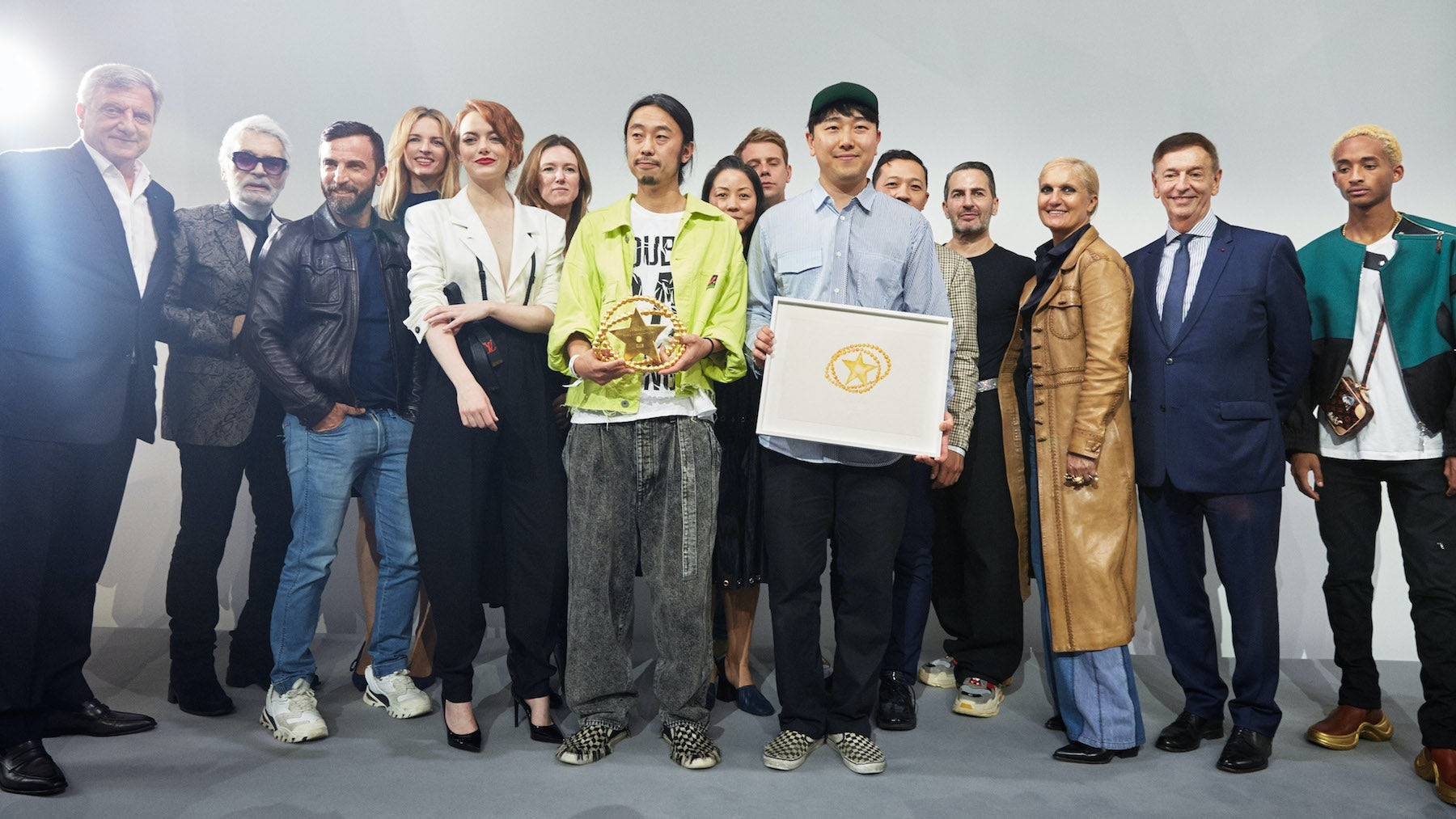 LVMH Prize 2018 winners Masayuki Ino and Rok Hwang along with the jury | Photo: Benoit Peverelli
