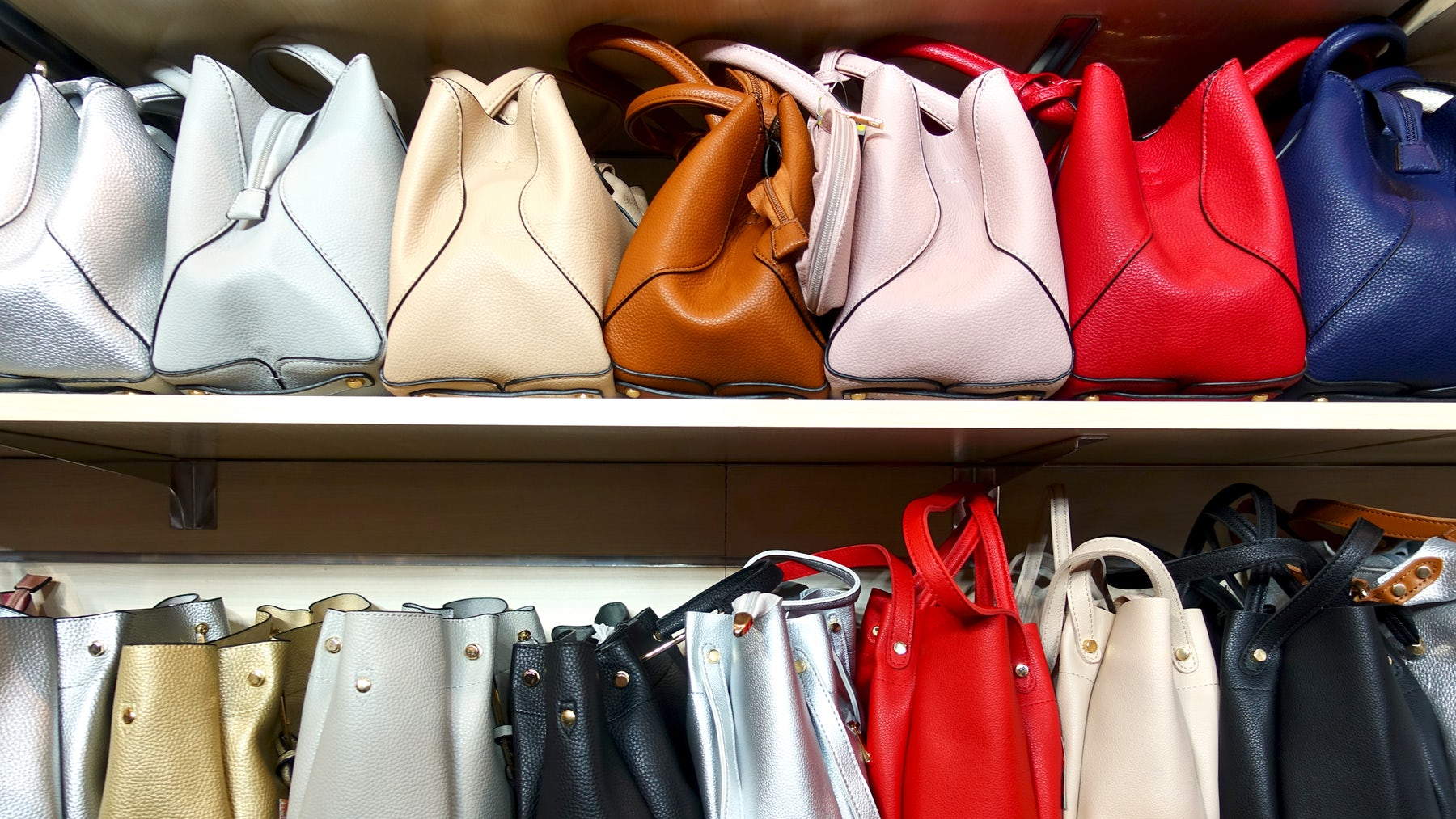 Luxury handbags in a store | Source: Shutterstock