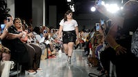 A model walks the runway for #TeeUpChange hosted By Dia&Co and the CFDA at theCURVYcon | Source: Daniel Zuchnik/Getty Images
