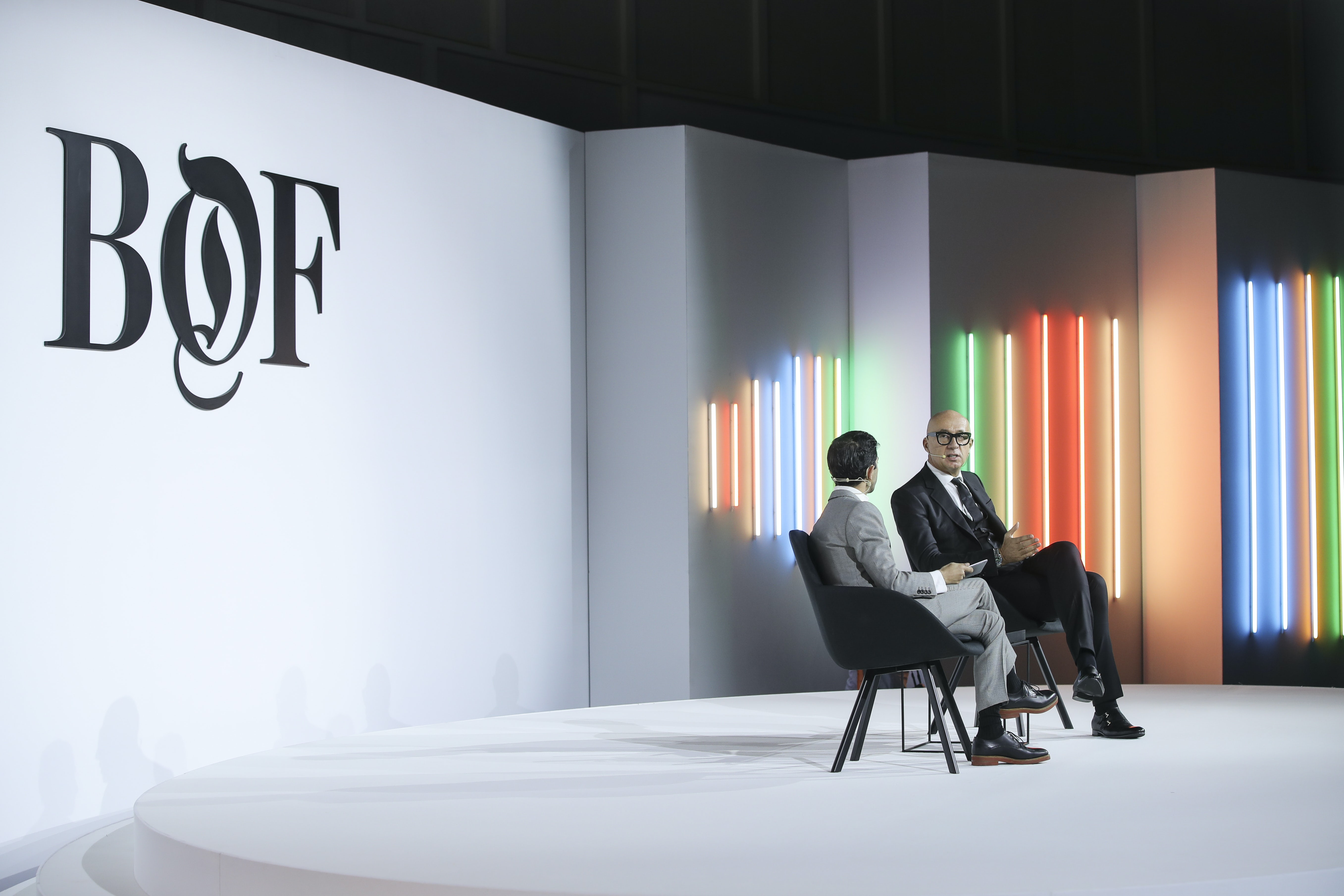Imran Amed and Marco Bizzarri on stage at the BoF China Summit during Shanghai Fashion Week | Source: Getty