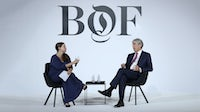 BoF Asia Correspondent Casey Hall in conversation Michael Ward on stage at the BoF China Summit during Shanghai Fashion Week | Source: Getty