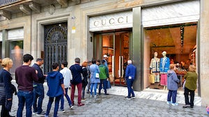 Line outside of a Gucci store | Source: Shutterstock