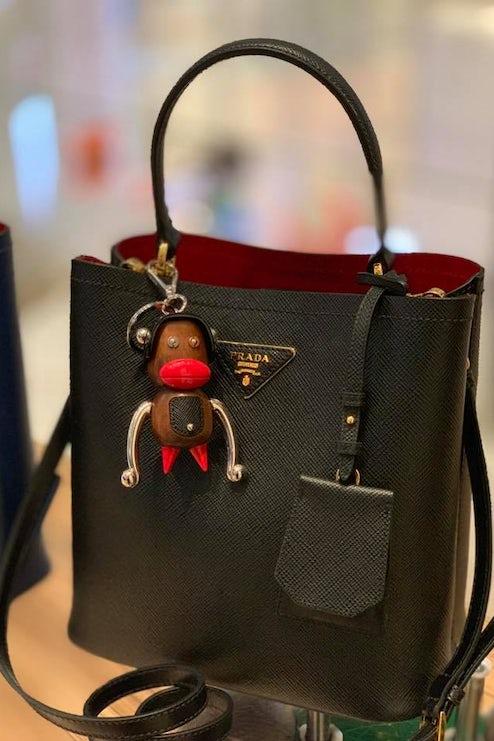 be3fbbd61e14 Prada Will Stop Selling $550 Monkey Figure Decried as Racist | News ...