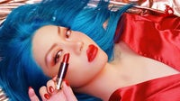 Influencer Melilim Fu poses with an Urban Decay lipstick | Source: Melilum Fu