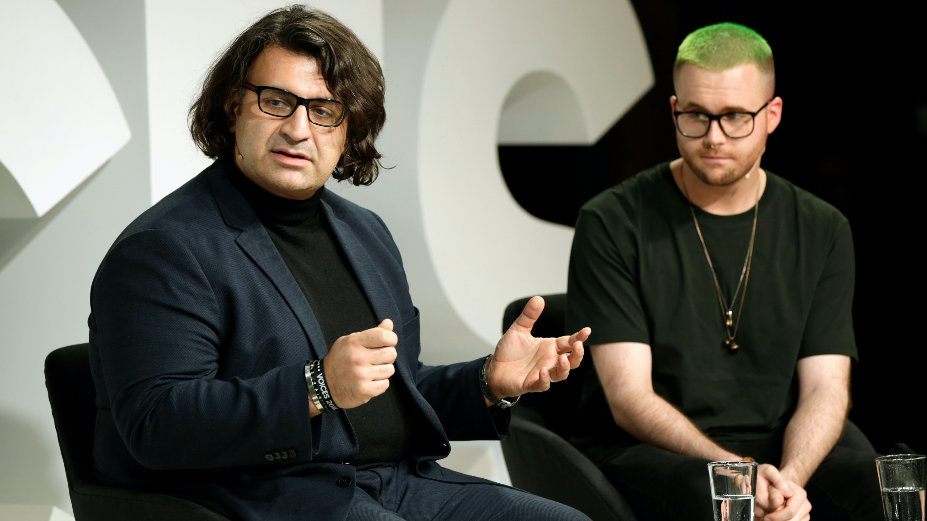 Arti Zeighami and Christopher Wylie speak on stage during #BoFVOICES