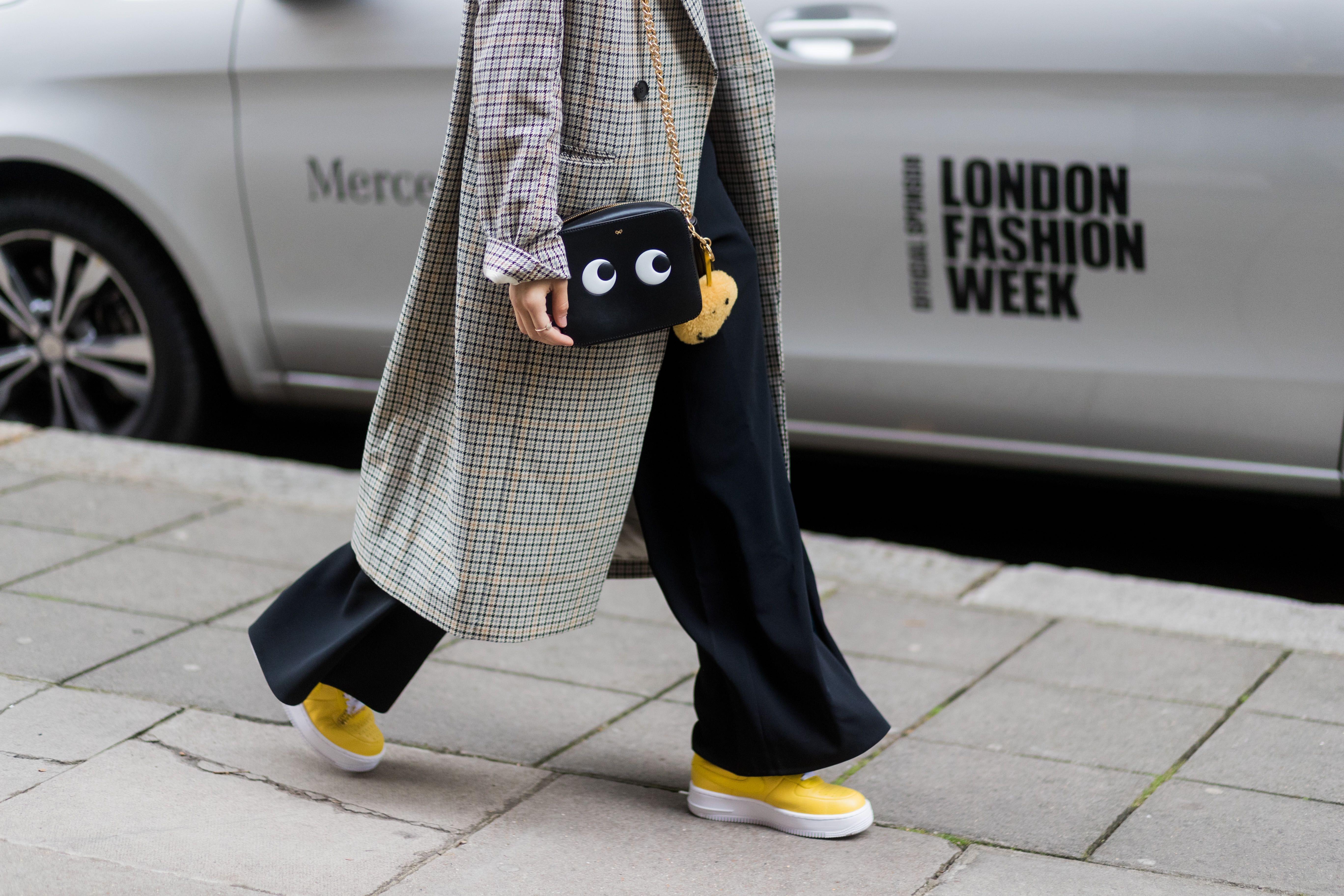 Caroline Daur wears Anya Hindmarch 'Eyes' bag during London Fashion Week in 2017 | Source: Getty Images