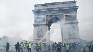 Yellow vest protesters surround the Arc de Triomphe on the Champs Elysées in Paris | Source: Shutterstock