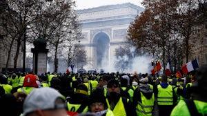Yellow vest protesters at the Champs-Élysées in Paris, France | Source: Shutterstock