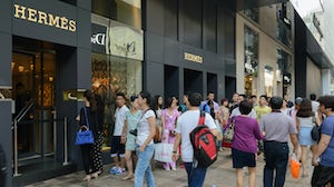Shoppers queue outside Hermès in Hong Kong, China | Source: Shutterstock