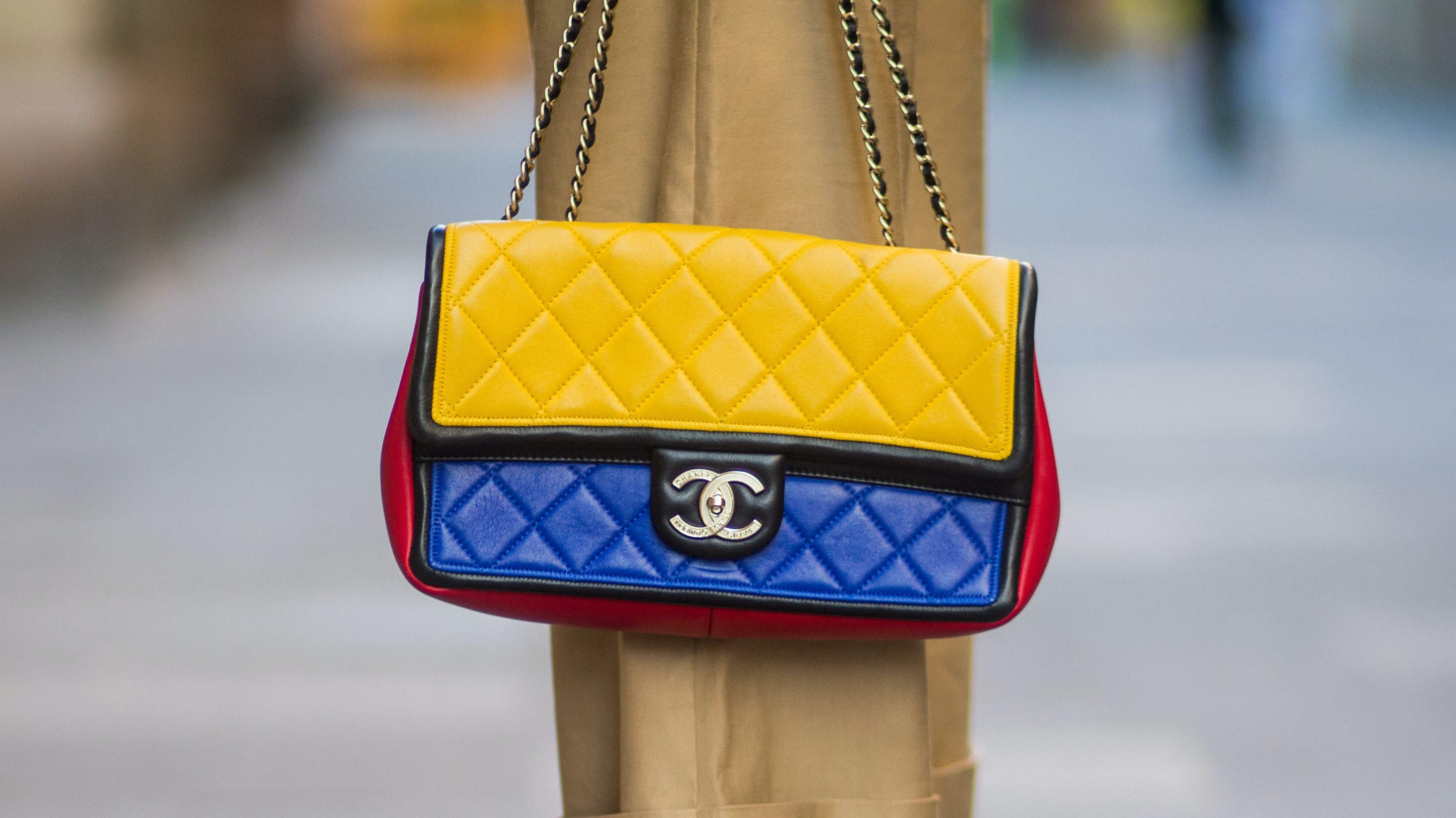 Chanel 2.55 bag in red, blue and yellow with golden logo buckle | Source: Getty