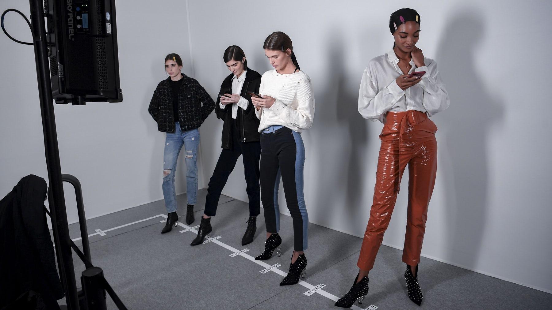 Models wait backstage at Paris Fashion Week Autumn/Winter 2019 | Source: Getty Images