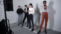 Models wait backstage at Paris Fashion Week Autumn/Winter 2019 | Source: Getty Images