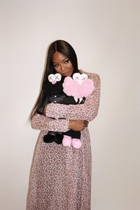 Naomi Campbell holding KAWS Dior dolls in the new issue of A Magazine Curated By | Photo: Hugo Scott