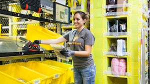 Amazon employee working at one of its fulfilment centres | Source: Amazon Press Centre