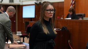 Fake German heiress Anna Sorokin is led away after being sentenced in Manhattan Supreme Court following her conviction last month | Source: Timothy A. Clary / AFP