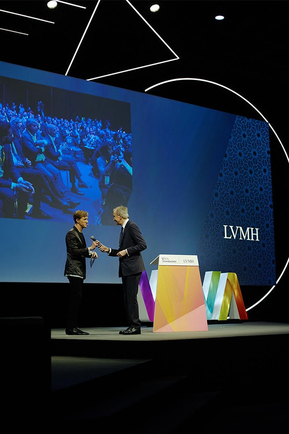 Ian Rogers and Bernard Arnault on stage   Source:  Édouard Jacquinet