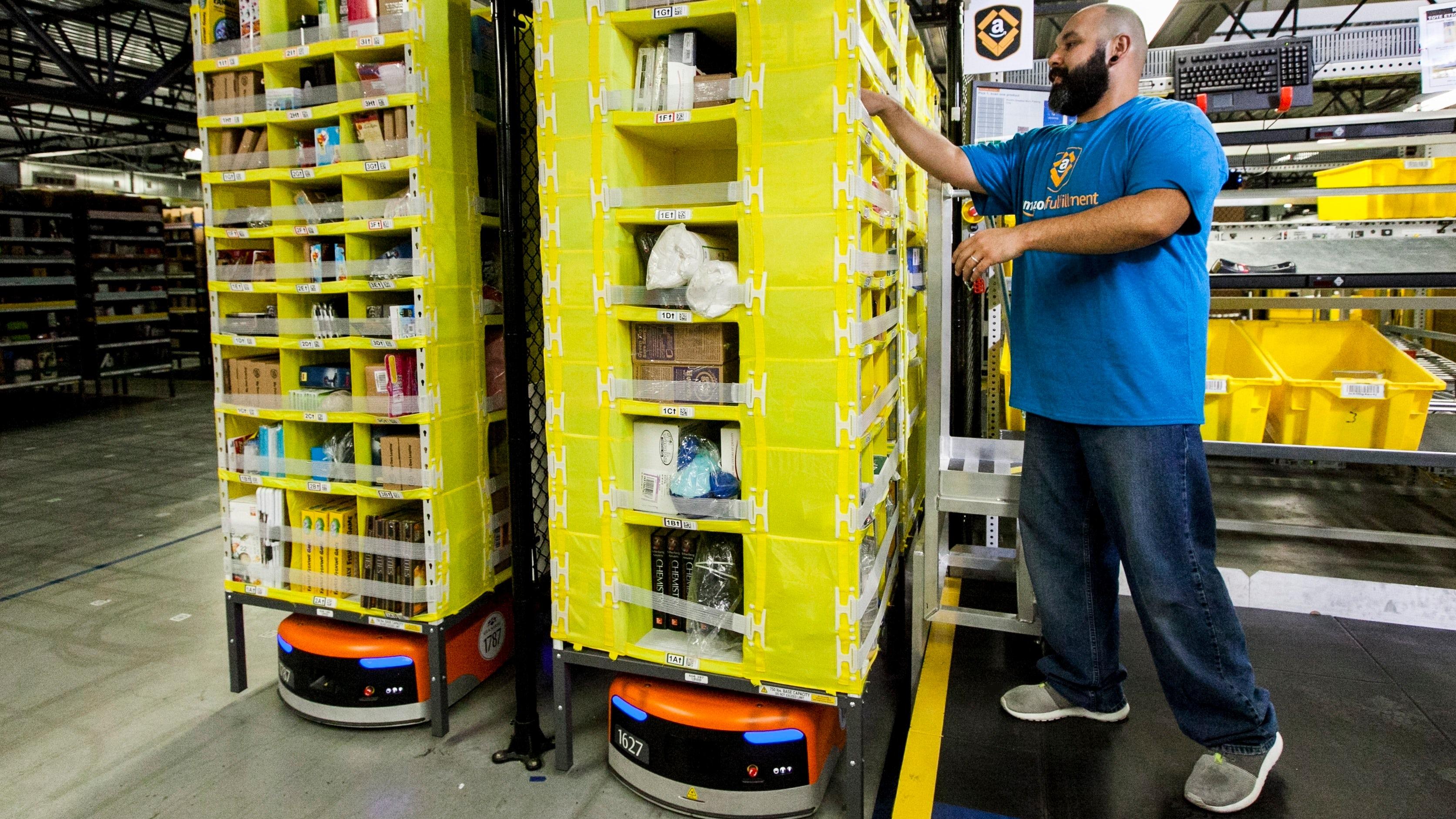 Employee picking with Amazon Robotics | Source: Amazon Press Centre