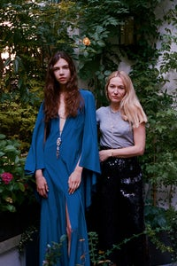 Julie de Libran and a model wearing her Blue Bird silk dress incorporating a piece of jewellery | Source: Sam Hellmann