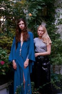 Julie de Libran and a model wearing her Blue Bird silk dress incorporating a piece of jewellery | Source: Sam Hellmann