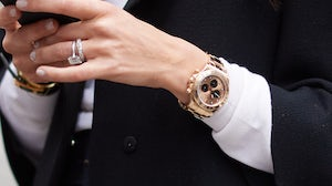 Woman wears Rolex Daytona Chronograph in rose gold | Source: Getty Images