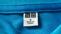 Label tag on Uniqlo shirt | Source: Shutterstock