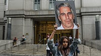 A protester holding a Jeffrey Epstein sign in front of the New York federal courthouse on July 8, 2019 | Source: Getty Images