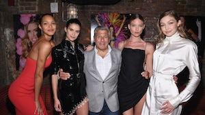 Victoria's Secret executive Ed Razek with models Lais Ribeiro, Sara Sampaio, Martha Hunt and Gigi Hadid at a book launch in 2018 | Photo: Getty