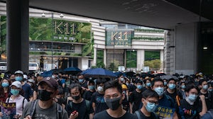 Protesters march on a street on August 3, 2019 in Hong Kong, China. | Source: Getty Images