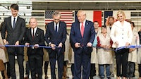 Alexandre Arnault, Louis Vuitton CEO Michael Burke, President Donald J. Trump, LVMH Chairman Bernard Arnault and First Daughter Ivanka Trump participate in a ribbon-cutting ceremony at Louis Vuitton's new factory in Texas | Source: Courtesy