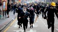 Protestors in Hong Kong on October 1, 2019 | Source: Shutterstock