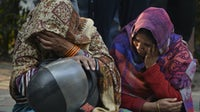 Relatives of the fire victims mourning outside the hospital | Source: Getty Images