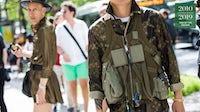 A guest at Paris Men's Fashion Week 2018 wearing a Supreme for Louis Vuitton camouflage jumpsuit | Source: Getty Images