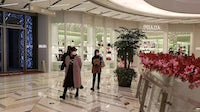 Customers wearing face masks at a luxury mall in Shanghai   Source: Casey Hall