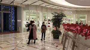 Customers wearing face masks at a luxury mall in Shanghai | Source: Casey Hall