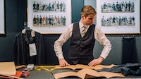 Huntsman's head cutter and creative director, Campbell Carey, working in No.11 Savile Row | Source: Courtesy