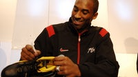 Kobe Bryant unveiling his All-Star 2006 Nike Kobe I basketball sneakers on February 16, 2006 in Houston, Texas. | Getty Images