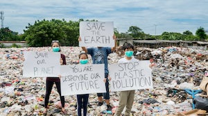 A group holds a banner to protest plastic waste in a landfill in Jakarta | Source: Shutterstock