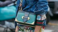 Woman with a green Prada bag at Milan Fashion Week 2017 | Source: Shutterstock