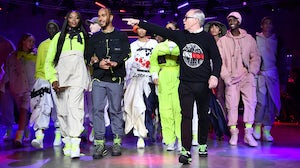 Naomi Campbell, Lewis Hamilton and Tommy Hilfiger on the runway | Source: Gareth Cattermole/BFC/Getty Images