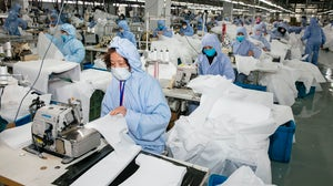 Workers at a factory in Wuxi, in China's eastern Jiangsu province | Source: STR / AFP via Getty Images