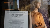A sign announces Bergdorf Goodman's temporary closure | Source: Victor J. Blue/Getty Images