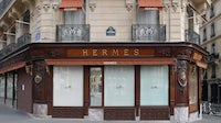 A closed Hermès shop after Paris went into lockdown in March | Source: Stephane Cardinale - Corbis/Corbis via Getty Images