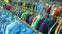 Racks of clothing at a second-hand store | Source: Shutterstock