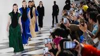 Models walk the runway during the Loewe show at Paris Fashion Week | Source: Getty